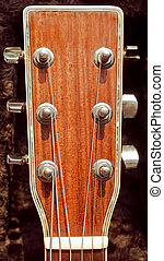 acoustic guitar headstock - musical background closeup image...