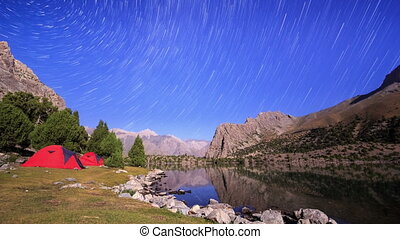 Stars reflected in the lake. Traces of stars similar to metory. TimeLapse. Pamir, Tajikistan