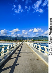 Pier, beach and Apuane mountains in Forte dei Marmi Versilia...