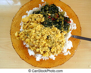 ackee and rice in plate - ackee and rice with callaloo
