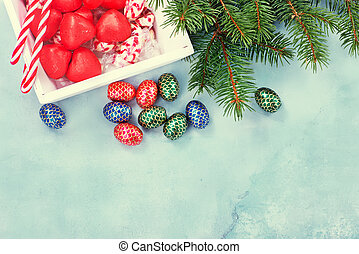christmas background - christmas candy on a table, chocolate...