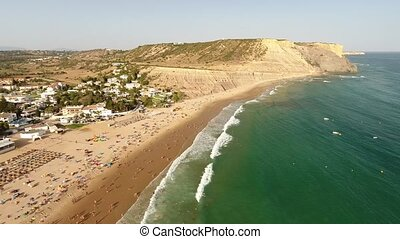 Aerial. Video flight over the beach Luz in Lagos. Portugal...