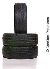 Worn Out Tires - Old tires stacked, isolated on white...