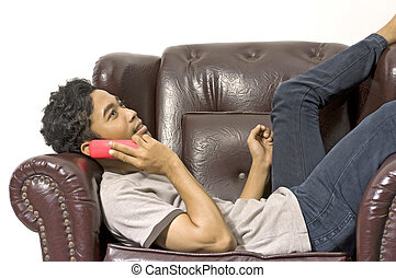 Man Calling His Friend - Man calling someone and sitting on...