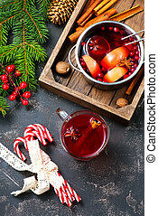 christmas drink with aroma spice on a table