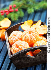 mandarins - fresh mandarins on a table, christmas background