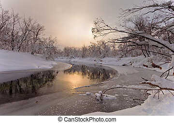 The river in the winter at sunset in Russia on the peninsula...