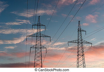 silhouettes of power lines on sunset background.