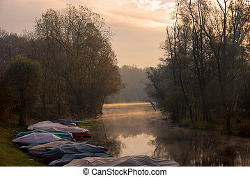 Ticino river at sunrise - Ticino river and its forest and...