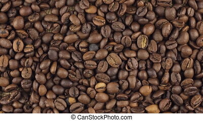 Slow rotation of the heap of coffee beans. View from above