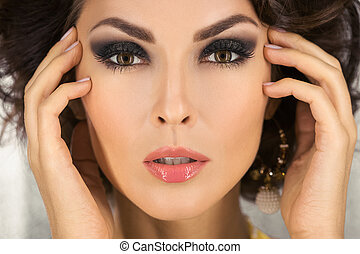 Beautiful face of a glamour woman with smoky eyes make-up....