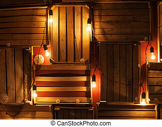 beautiful lights on wooden wall. decor for Christmas shoot.