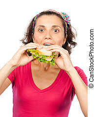 Hungry pretty girl eats a sandwich
