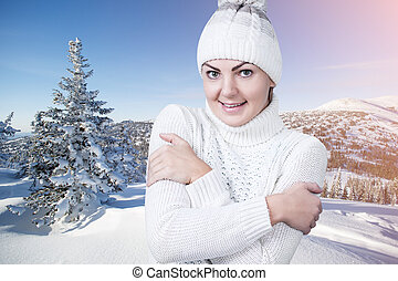 Beautiful woman in the winter snowy scenery.
