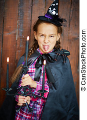 Celebration is fun - Funny girl in Halloween costume with...