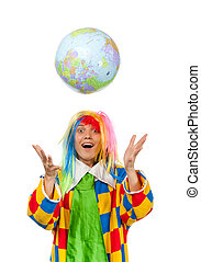 Funny clown throws globe ball