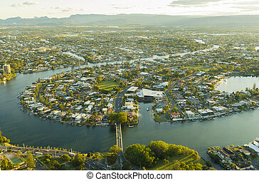 Aerial view of waterfront houses during sunset - Aerial view...