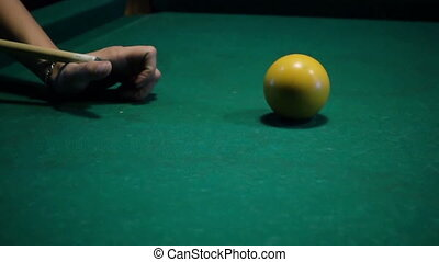 Young woman playing billiard. First shot
