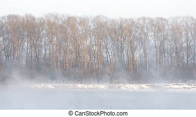 Ice formations on the river. Rising the fog