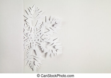 Fine paper snowflake cut out, Christmas background