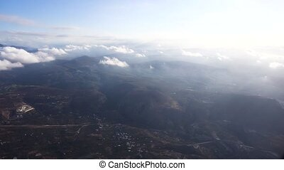 clouds moving fast. footage from airplane