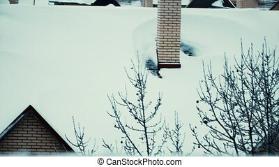 Snow covered sloped roofs of residential houses in winter 4K...