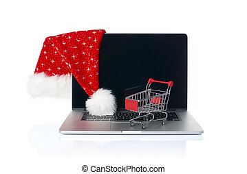 Online Christmas shopping. A set up with laptop, small...