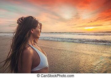 Woman in bikini at sunset - Beautiful sexy woman in bikini...