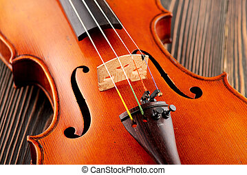 Close up of a violin detail on wooden table