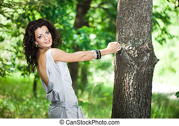 tender girl in the garden with trees