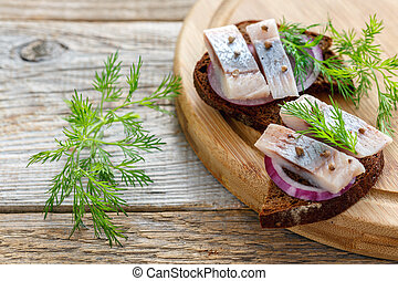 Herring spiced salting and a slice of rye bread.