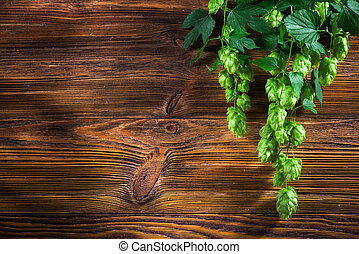 Hop twig on brown wooden table