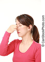 woman suffers from Asthenopia - studio shot of middle aged...