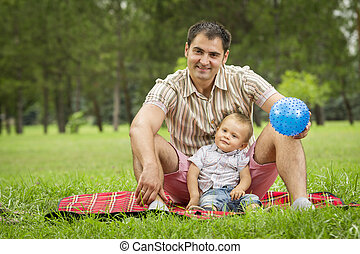 Father with baby son in park