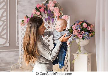 happy mother with baby in the room