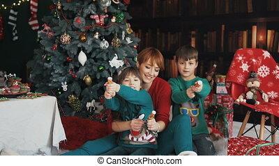 Family Having Fun with Christmas Petards
