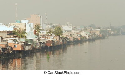 Views of the city's slums from the river 4 - Views of the...