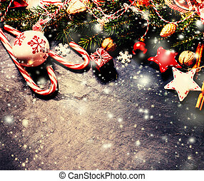 Retro Christmas decorations on dark background in vintage...