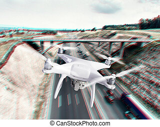 Hovering drone taking pictures of highway and bridge,...