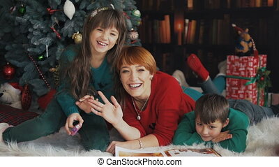 Happy Family near Christmas Tree - Mother with her kids...