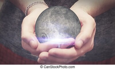 the moon revolves in man hands