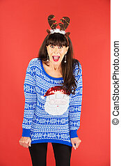 Excited woman in antlers tiara and sweater - Excited...