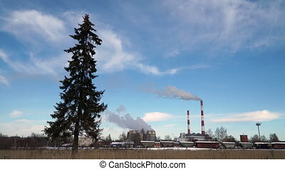 Thermal power plant or a factory with Smoking chimneys and a...