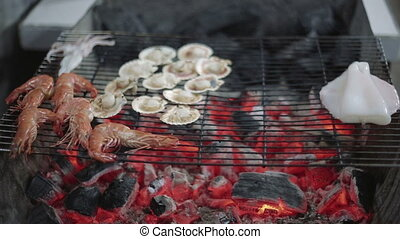Seafood barbecue, shrimp and scallops on the grill delicious...