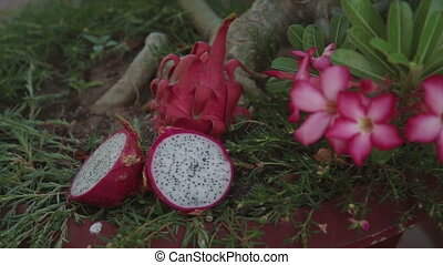 Beautiful fresh sliced white dragon fruit as background,...