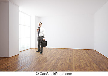 Man in unfurnished room - Businessman in unfurnished...