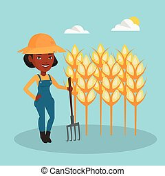 Farmer with pitchfork at wheat field.