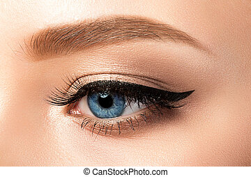 Close up view of blue woman eye with beautiful makeup -...