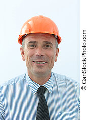 experienced engineer in orange helmet and a positive...
