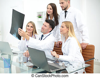 Portrait of confident happy group doctors working at the...